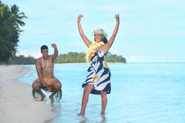 olynesian Pacific Islander man and woman dancing at Muri lagoon in Rarotonga Cook Islands